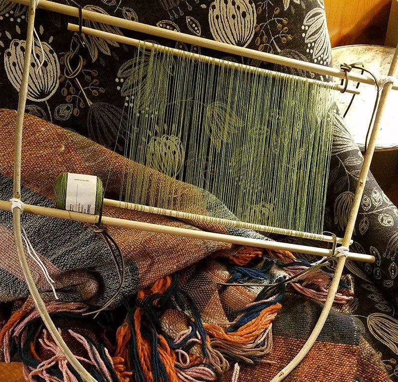 Lap loom being warped for sprang hairnet.